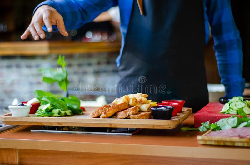 Chef is breakfast preparing in the restaurant. Turkish breakfast . Chef is breakfast preparing in the restaurant royalty free stock photo