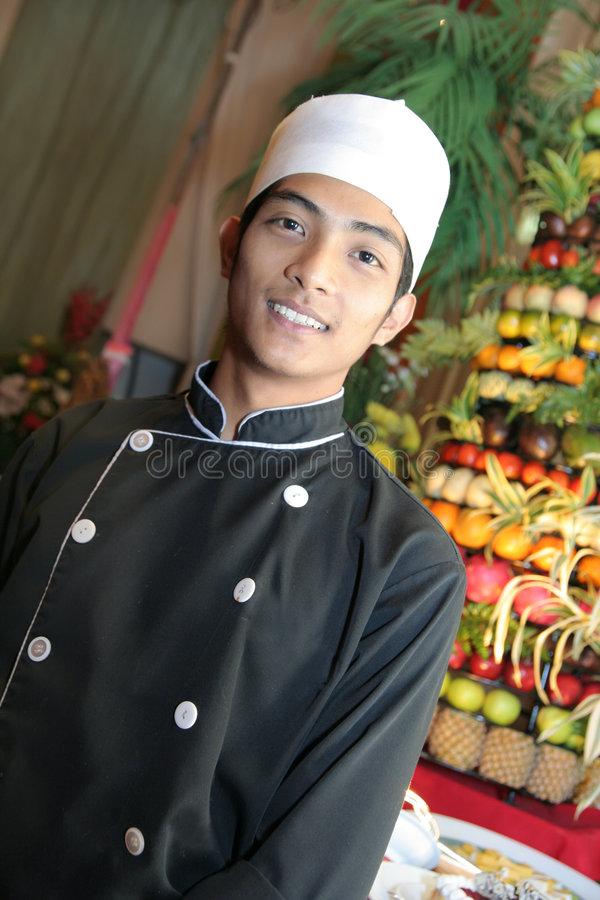 Chef in buffet smiling royalty free stock photos