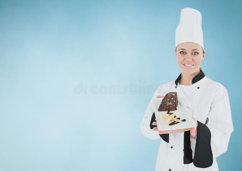 Chef with cake slice against blue background royalty free illustration