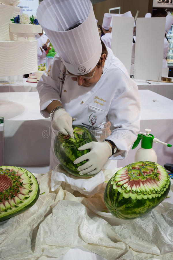 Chef carves a watermelon at Host 2013 in Milan, Italy