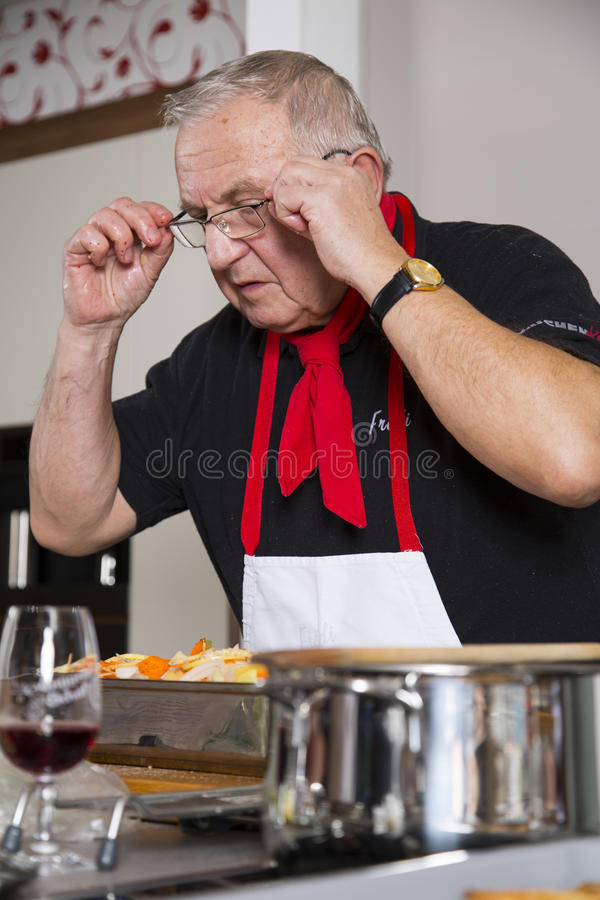 The Chef Checks The Recipe Stock Images