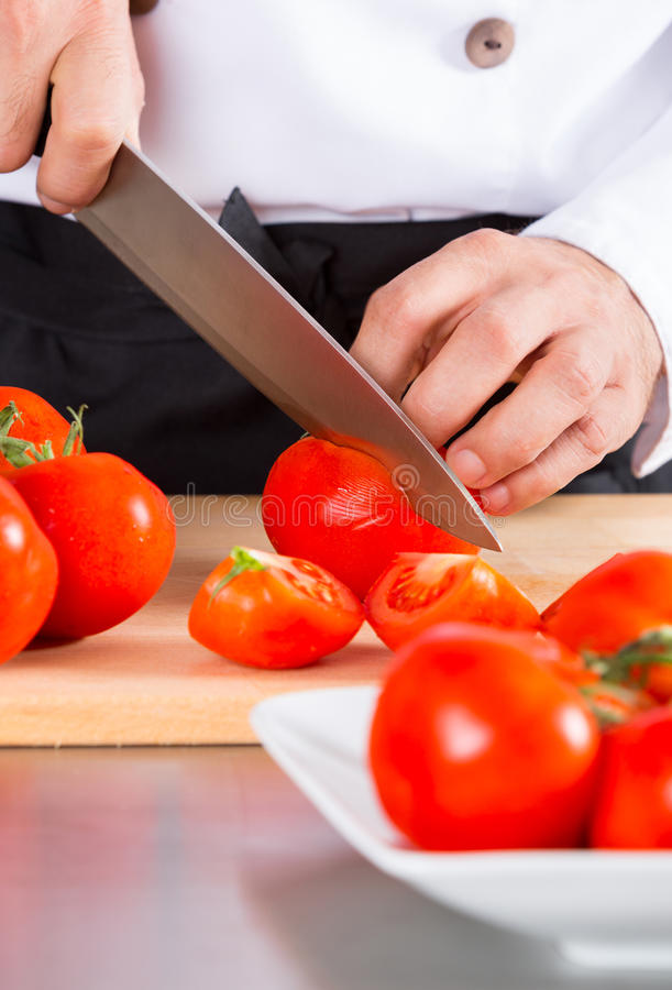 Chef chopping vegetables stock photos