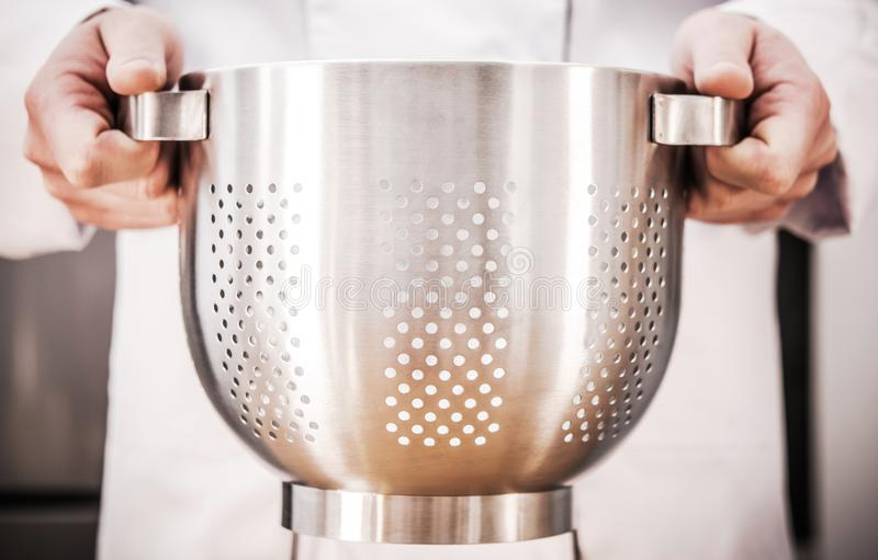Chef with Colander in Hands royalty free stock photography