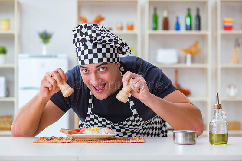 The chef cook cooking a meal breakfast dinner in the kitchen. Chef cook cooking a meal breakfast dinner in the kitchen stock photo
