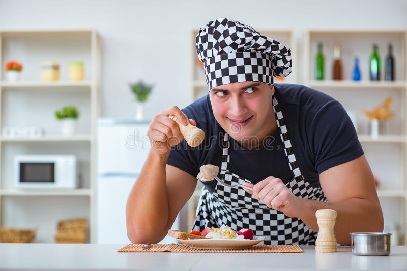 The chef cook cooking a meal breakfast dinner in the kitchen. Chef cook cooking a meal breakfast dinner in the kitchen royalty free stock image