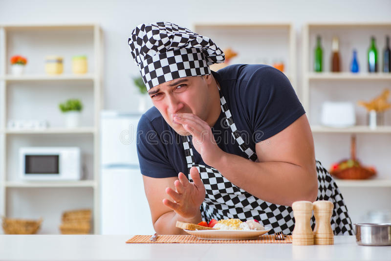 The chef cook cooking a meal breakfast dinner in the kitchen. Chef cook cooking a meal breakfast dinner in the kitchen royalty free stock photography