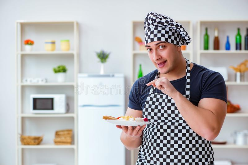 The chef cook cooking a meal breakfast dinner in the kitchen. Chef cook cooking a meal breakfast dinner in the kitchen royalty free stock photos