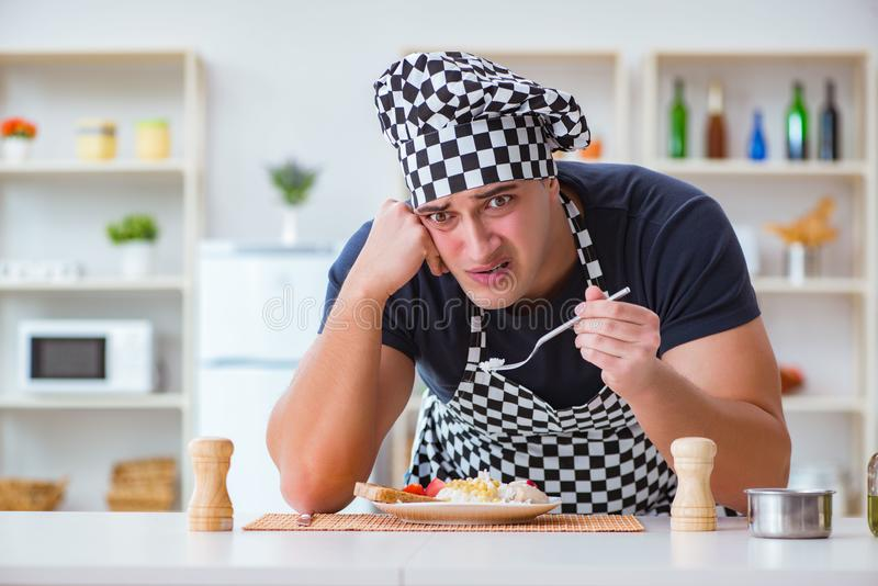 The chef cook cooking a meal breakfast dinner in the kitchen. Chef cook cooking a meal breakfast dinner in the kitchen royalty free stock photo
