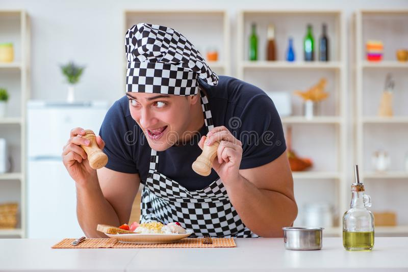 The chef cook cooking a meal breakfast dinner in the kitchen. Chef cook cooking a meal breakfast dinner in the kitchen royalty free stock images
