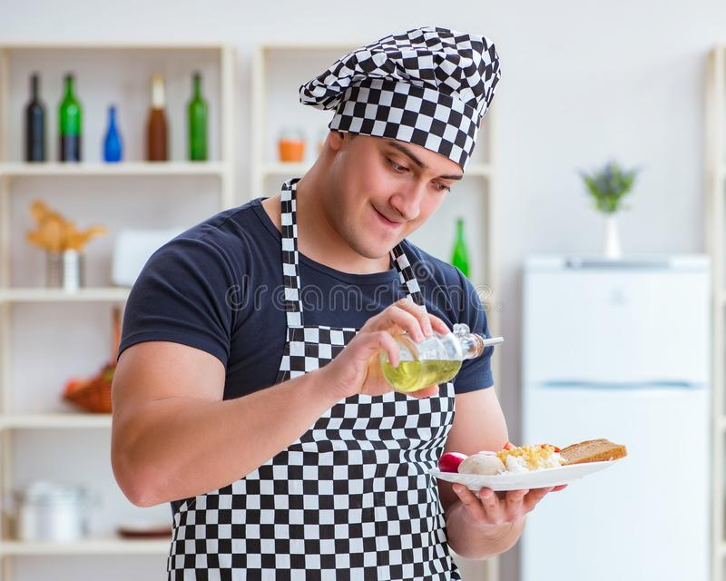 Chef cook cooking a meal breakfast dinner in the kitchen. The chef cook cooking a meal breakfast dinner in the kitchen royalty free stock photo