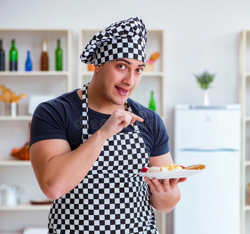 Chef cook cooking a meal breakfast dinner in the kitchen. The chef cook cooking a meal breakfast dinner in the kitchen royalty free stock image