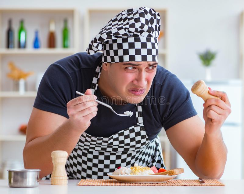 Chef cook cooking a meal breakfast dinner in the kitchen. The chef cook cooking a meal breakfast dinner in the kitchen royalty free stock images