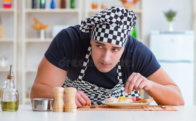 Chef cook cooking a meal breakfast dinner in the kitchen. The chef cook cooking a meal breakfast dinner in the kitchen royalty free stock photos