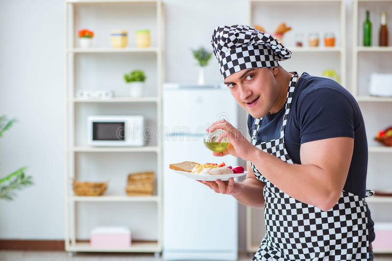 The chef cook cooking a meal breakfast dinner in the kitchen. Chef cook cooking a meal breakfast dinner in the kitchen stock images