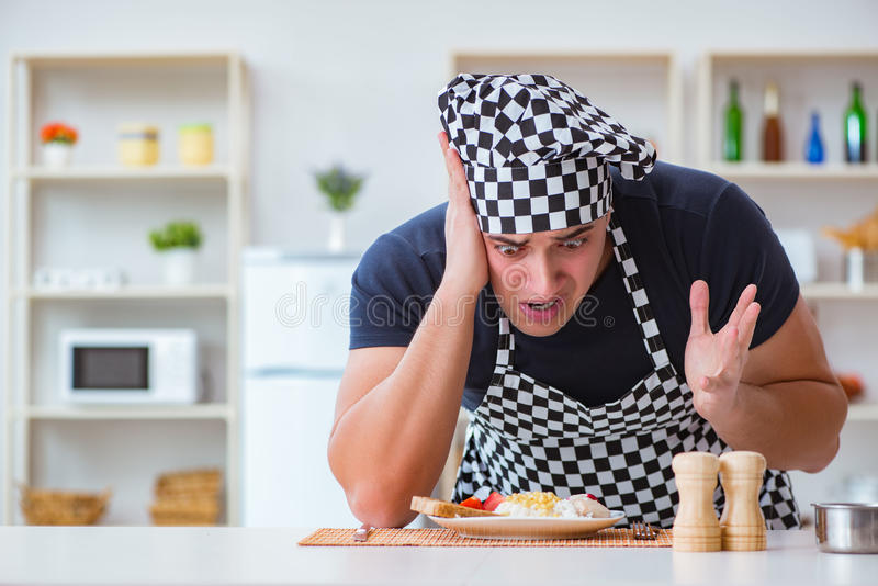 The chef cook cooking a meal breakfast dinner in the kitchen. Chef cook cooking a meal breakfast dinner in the kitchen stock image