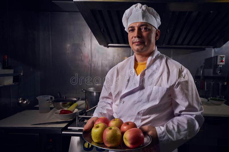 Chef cook, great design for any purposes. Cooking concept. Kitchen portrait. Healthy food. Diet concept. Chef concept royalty free stock photography