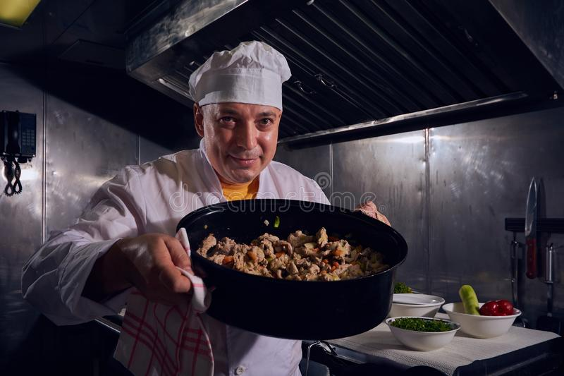 Chef cook, great design for any purposes. Cooking concept. Kitchen portrait. Healthy food. Diet concept. Chef concept stock photography