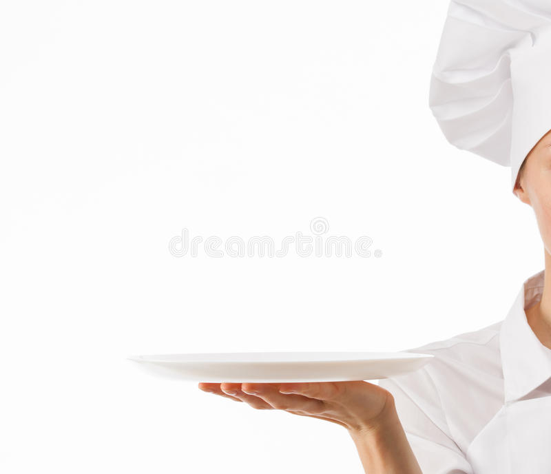 Chef cook holding white plate. Chef cook holding an empty plate on white background stock photo