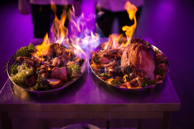Chef, Meat poured alcohol and set fire to royalty free stock image