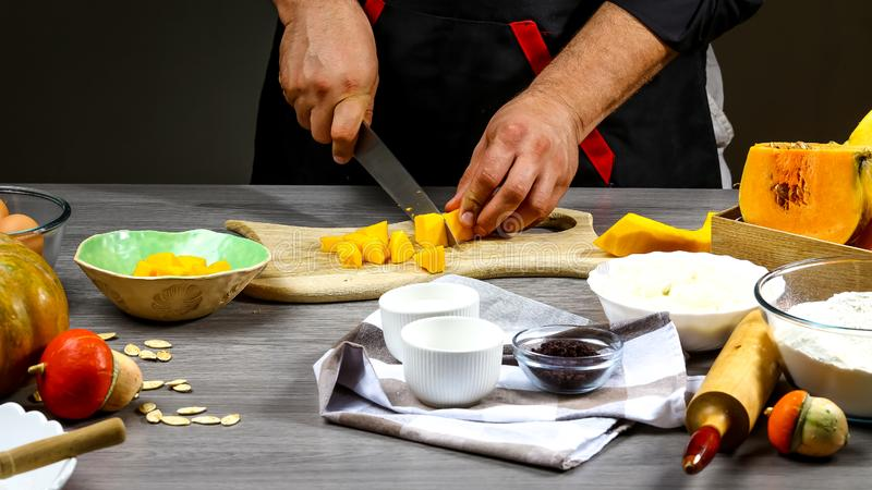 Chef cooking American pumpkin pie. Food concept background stock photography