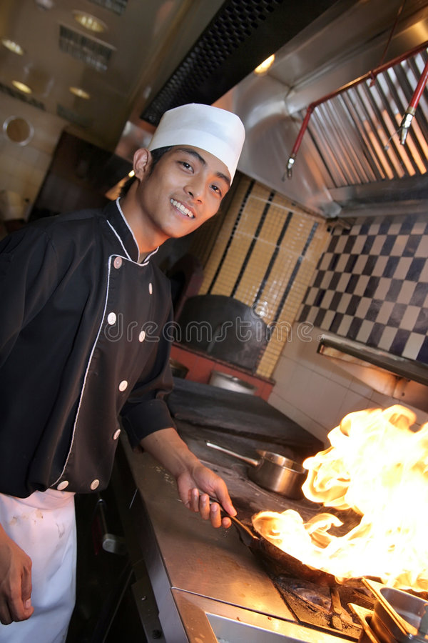 Chef cooking at dinner stock photography