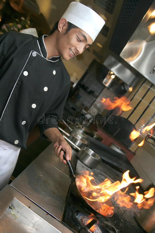 Chef cooking at dinner royalty free stock image