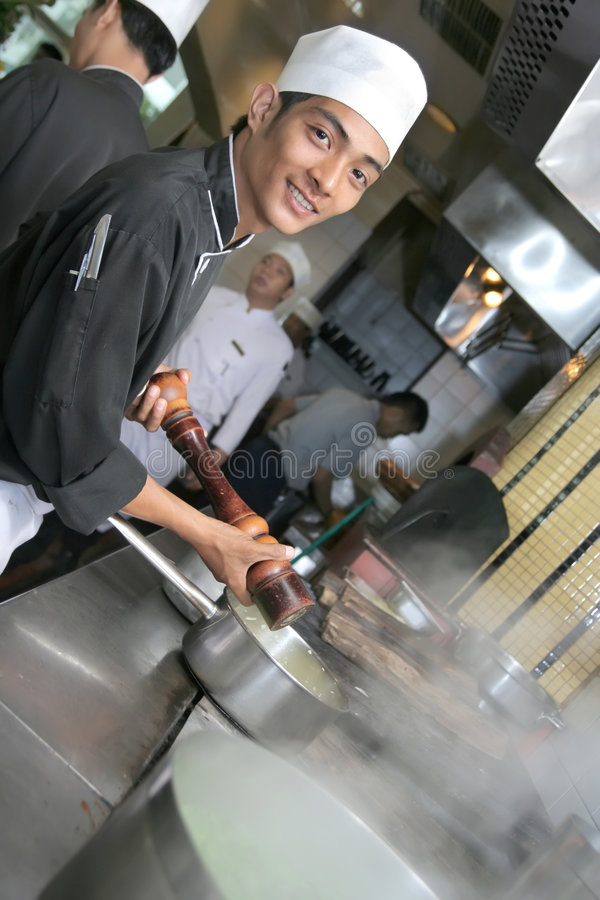 Chef cooking at dinner royalty free stock photo