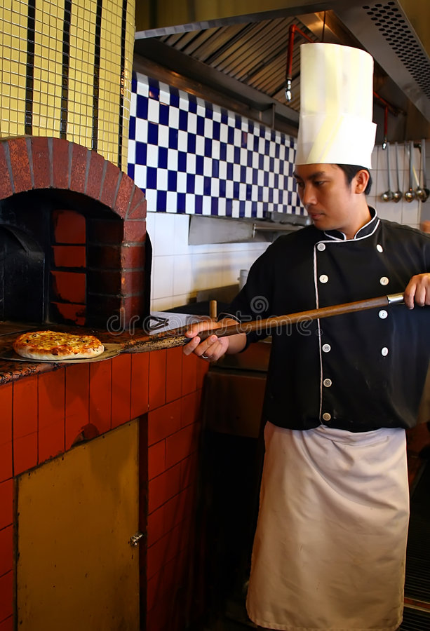 Chef cooking pizza stock photography