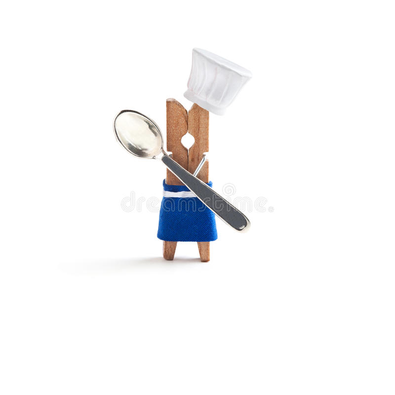 Chef cooking with spoon on white background. Funny clothespin restaurant character dressed in hat, blue apron. Kids menu stock photos