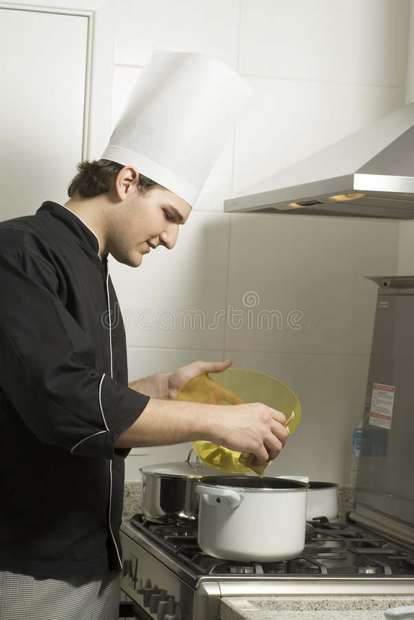 Chef Cooking on Stove stock photo