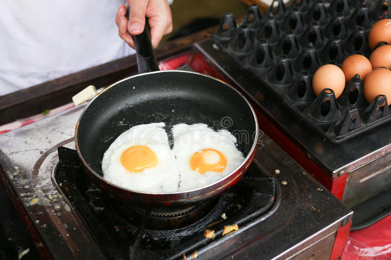 Download A Chef Is Cooking Sunny-side Up Eggs Stock Image - Image: 30170371