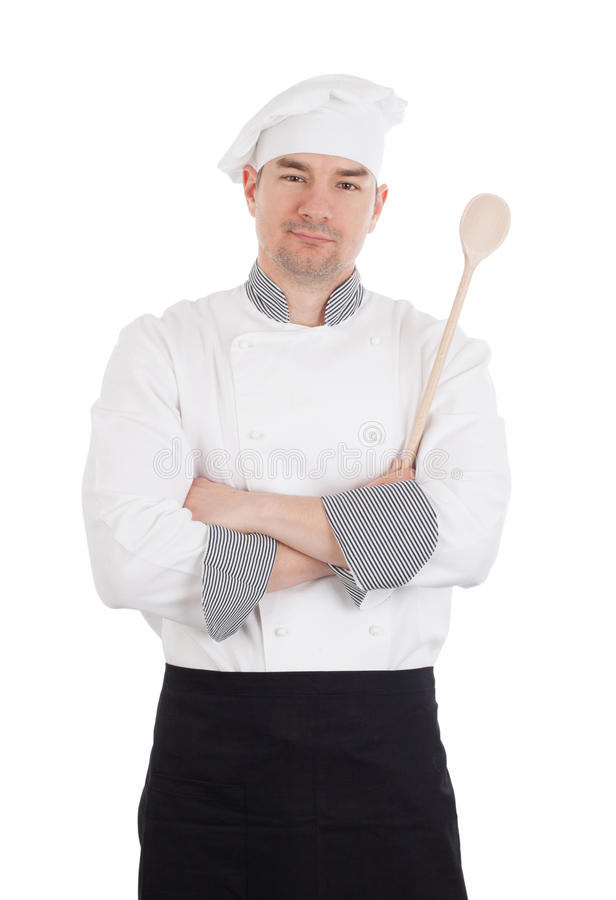 Chef crossing arms holding wooden spoon. Young chef crossing arms and holding wooden spoon stock photo