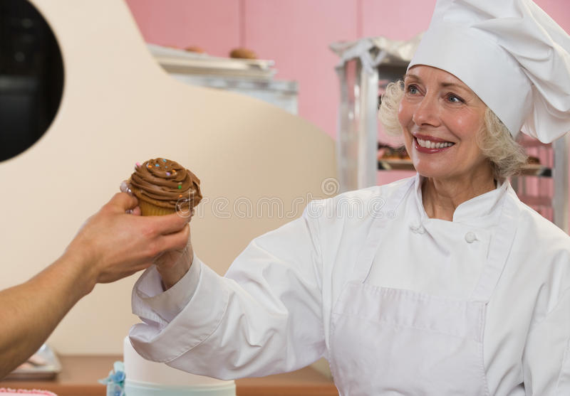 Chef with cupcake royalty free stock image