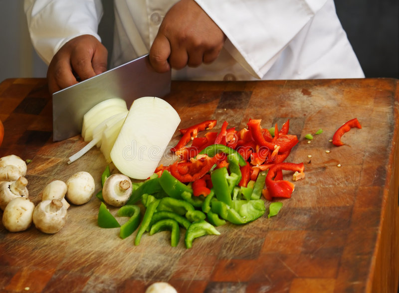 Chef Cutting Vegetables Close Up stock photo