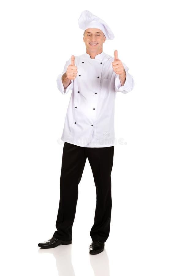 Chef dans le chapeau blanc avec le signe correct images libres de droits