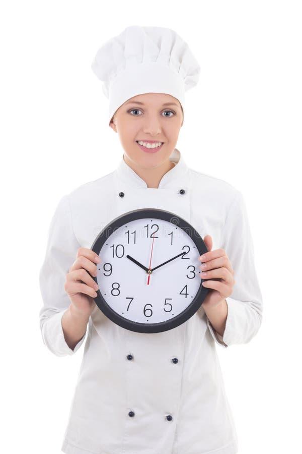 Chef de jeune femme dans l'horloge se tenante uniforme de bureau d'isolement sur le whi photos stock