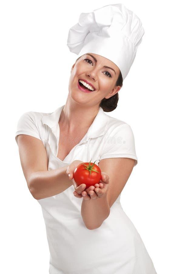 Chef de jeune femme montrant des ingrédients pour la nourriture italienne images libres de droits