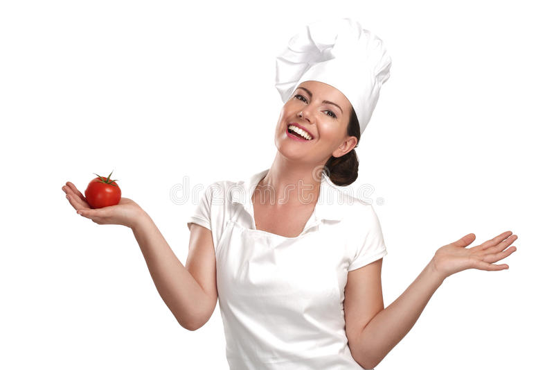 Chef de jeune femme montrant des ingrédients pour la nourriture italienne photos stock