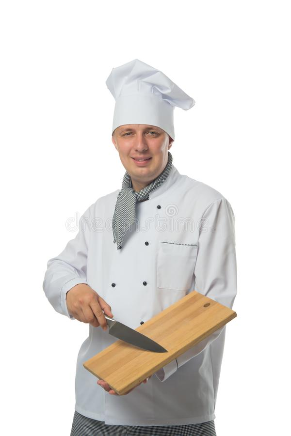 Chef de sourire, tenant un couteau et une planche à découper photographie stock libre de droits