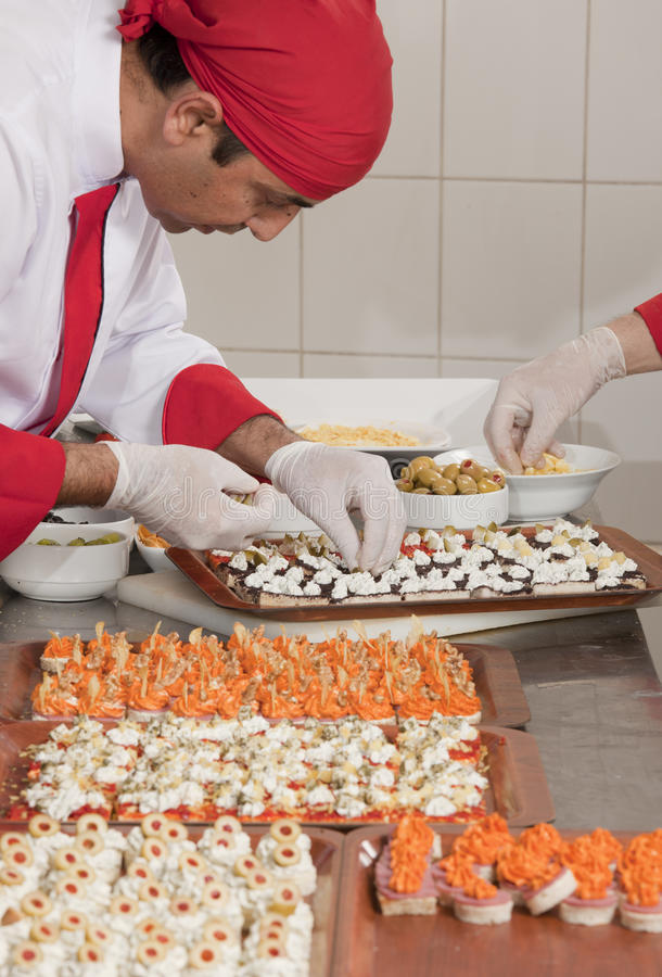 Chef Decorating canapes stock image