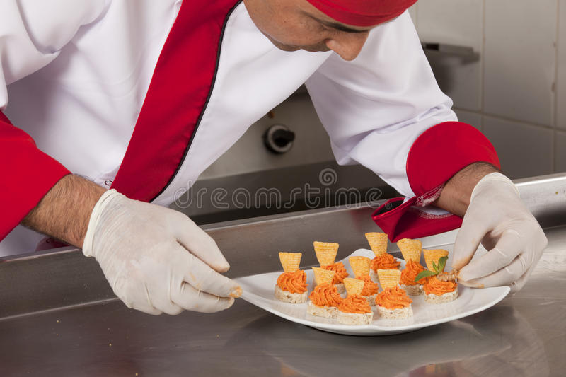 Chef Decorating canapes royalty free stock photos