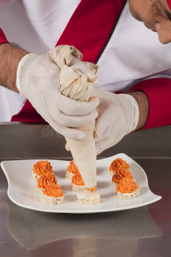 Chef Decorating canapes royalty free stock photo