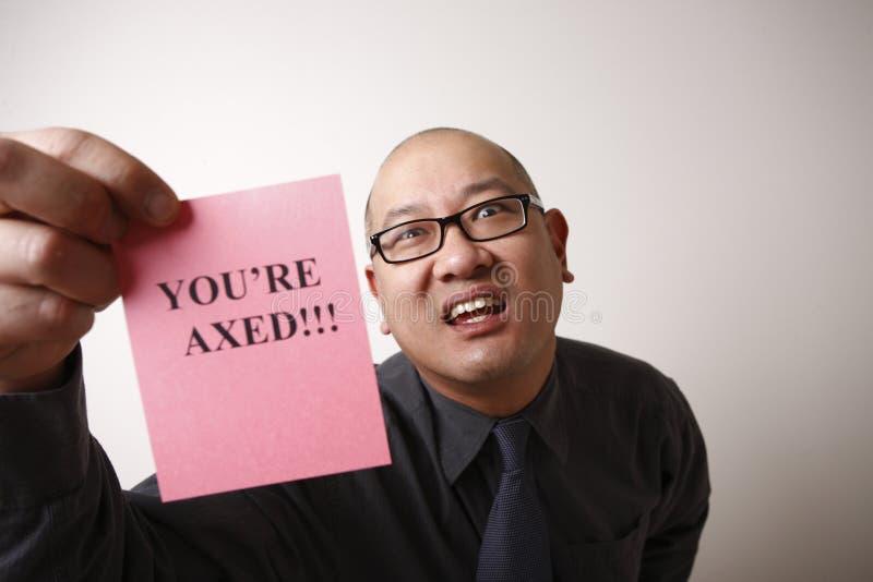 Chef, der rosafarbenen Beleg übergibt lizenzfreies stockbild