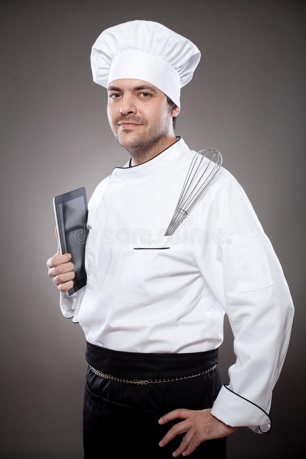 Chef with digital tablet stock photo