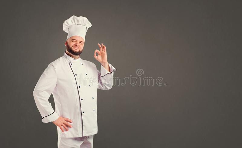 Chef drôle avec le cuisinier de barbe images stock