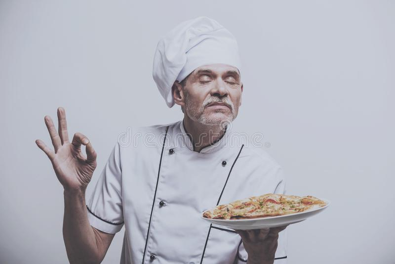 Chef Enjoys Scent of Pizza. stock image