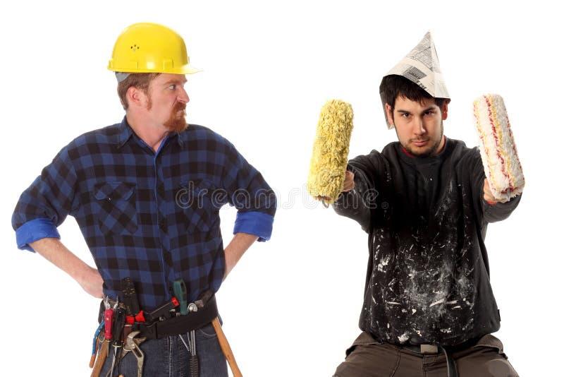 Chef et peintre de maison fâchés photographie stock libre de droits