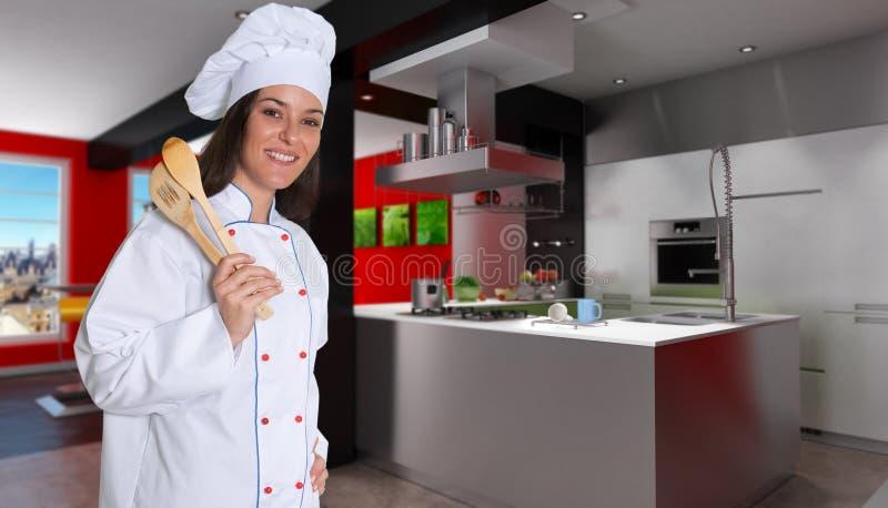 Chef féminin dans une cuisine rouge et noire de créateur photo stock