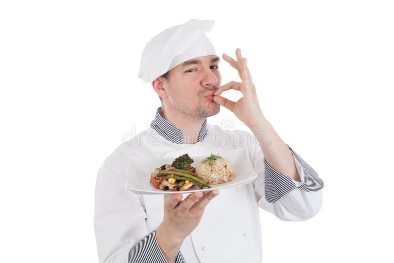Chef faisant le geste CORRECT après nourriture de bon goût photos stock