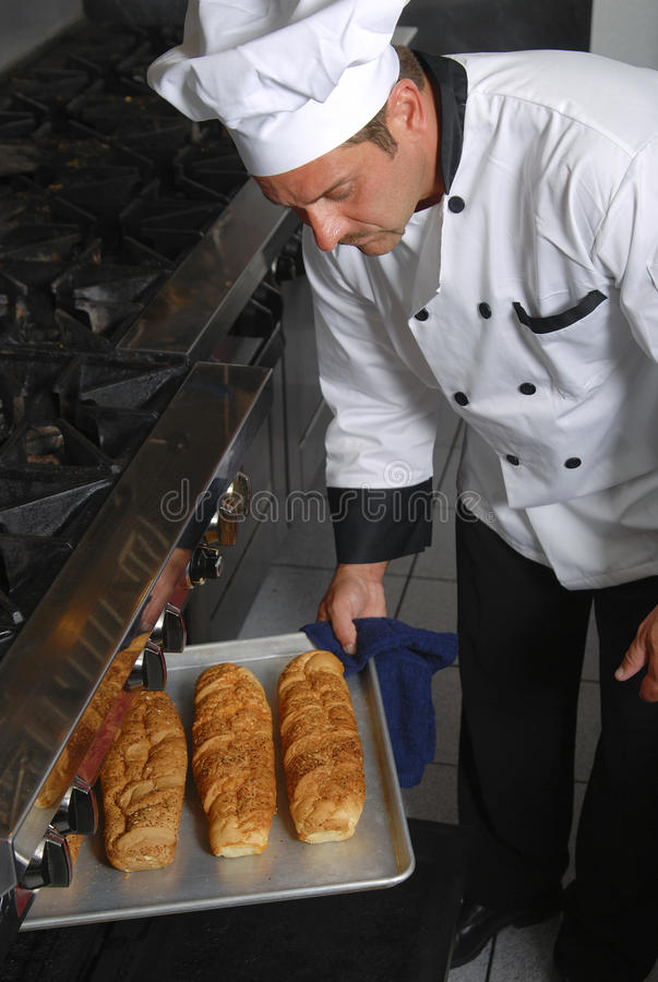 Chef with fresh bread royalty free stock photo